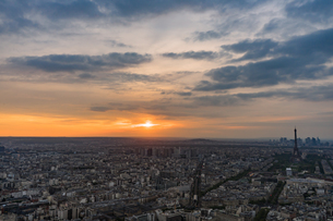 Aerial View Of Cityscape Against Cloudy Sky During Sunsetの写真素材 [FYI04469152]