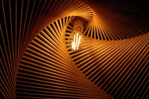 Low Angle View Of Illuminated Light Bulb In Decorationの写真素材 [FYI04470837]