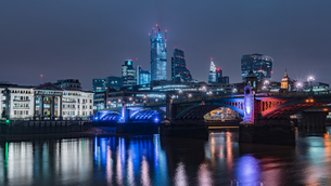 Illuminated Buildings By River Against Sky In City At Nightの写真素材 [FYI04472194]