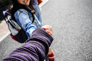 Close-up High Angle View Of Friends Holding Hands On Streetの写真素材 [FYI04472446]