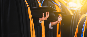 Midsection Of People Wearing Graduation Gownsの写真素材 [FYI04473310]