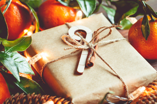Close-up Of Orange Fruits And Gift Box On Tableの写真素材 [FYI04474900]