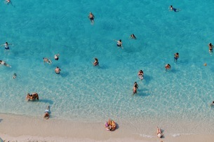 High Angle View Of People Swimming In Seaの写真素材 [FYI04475127]