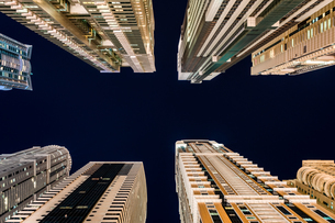 Low Angle View Of Skyscrapers In Dubai Against Sky At Nightの写真素材 [FYI04475268]