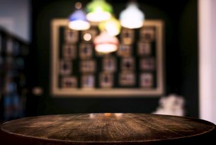 Close-up Of Table By Illuminated Lights At Homeの写真素材 [FYI04475680]