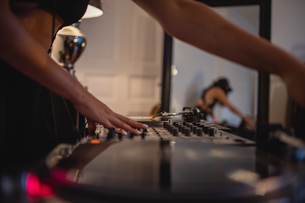 Midsection Of Woman Playing Sound Mixer At Homeの写真素材 [FYI04475828]