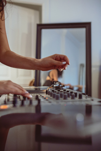 Cropped Hand Of Woman Playing Sound Mixer At Homeの写真素材 [FYI04475834]