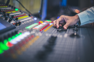 Cropped Hand Of Man Operating Sound Recording Equipment In Clubの写真素材 [FYI04476926]