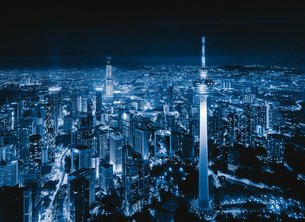 Aerial View Of Illuminated Buildings In City At Nightの写真素材 [FYI04477963]