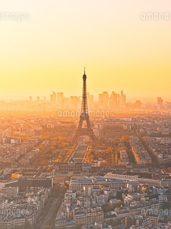 Eiffel Tower Amidst Buildings In City During Sunriseの写真素材 [FYI04478689]