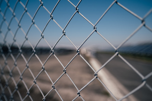 Chainlink Fence Against Skyの写真素材 [FYI04478809]