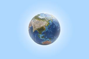青い空間に浮かぶ地球の写真素材 [FYI04539675]