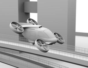 高速道路の上に飛行している空飛ぶクルマのクレイレンダリングイメージの写真素材 [FYI04614385]