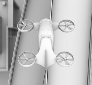 高速道路の上に飛行している空飛ぶクルマのクレイレンダリングイメージの写真素材 [FYI04614387]