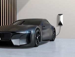自宅充電スタンドに充電している電動スポーツカーのイメージの写真素材 [FYI04614435]