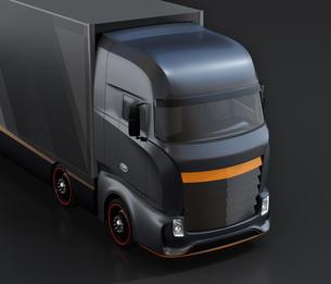 黒バックに大型電動トラックのクローズアップイメージの写真素材 [FYI04614531]