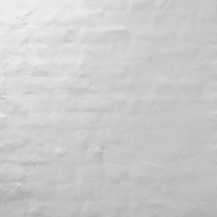 白い塗装のモルタル壁の写真素材 [FYI04642568]