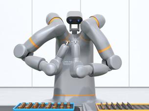 モータコイルを組み立てている双腕ロボットの正面イメージ。協働ロボットのコンセプトの写真素材 [FYI04645883]