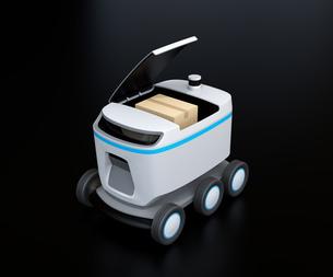 黒バックにデリバリーロボットのイメージ。ラストワンマイルコンセプトの写真素材 [FYI04645937]