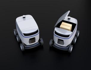 黒バックに2台デリバリーロボットのイメージ。ラストワンマイルコンセプトの写真素材 [FYI04645941]