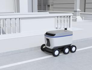 交差点の近くに走行中の配送ロボットのイメージ。ラストワンマイルコンセプトの写真素材 [FYI04645961]