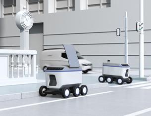 大都市交差点の近くに荷物の引き渡しを待機している配送ロボットのイメージの写真素材 [FYI04645967]