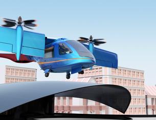 ヘリポートから離陸する空飛ぶタクシーのイメージ。短距離ライドシェアコンセプトの写真素材 [FYI04645980]
