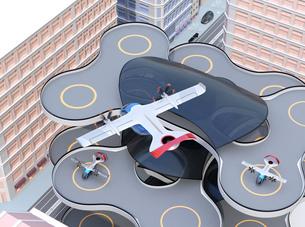 ヘリポートから離陸する空飛ぶタクシーのイメージ。短距離ライドシェアコンセプトの写真素材 [FYI04645985]