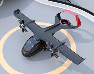 ヘリポートに駐機中のソーラーパネル付き空飛ぶタクシーのイメージ。短距離ライドシェアコンセプトの写真素材 [FYI04645989]