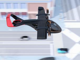 街の道路の上を通過する空飛ぶタクシーのイメージ。短距離ライドシェアコンセプトの写真素材 [FYI04645995]