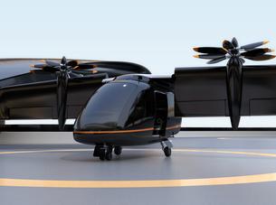 ヘリポートから離着陸準備する空飛ぶタクシーのイメージ。短距離ライドシェアコンセプトの写真素材 [FYI04646000]