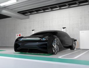 地下駐車場のチャージステーションに充電している電気自動車のイメージの写真素材 [FYI04646018]