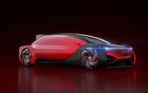黒バックにメタリックレッド色の自動運転電気自動車高級サルーンのイメージ。オリジナルデザインの写真素材 [FYI04646184]