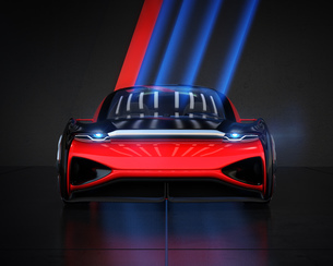 黒バックにメタリックレッド色の自動運転電気自動車高級サルーンの正面イメージの写真素材 [FYI04646185]