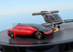ヘリパッドに自動運転車と空飛ぶタクシーのイメージ。MaaSのコンセプトの写真素材 [FYI04646257]