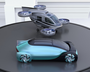 ヘリパッドに自動運転車と空飛ぶタクシーのイメージ。MaaSのコンセプトの写真素材 [FYI04646260]