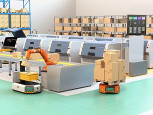 ラインから流れてきた荷物がロボットアームで無人搬送車AGVに運んでいる。スマート工場のコンセプトの写真素材 [FYI04646355]