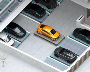 自動搬送ロボットAGVがクルマを駐車スペースに搬送している。自動駐車システムのコンセプトイメージの写真素材 [FYI04646389]