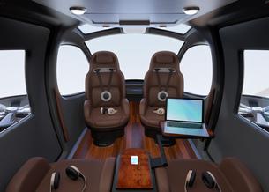 空飛ぶタクシーのインテリアイメージ。本革シートとキャビネットが備えて、移動中PCワークも可能の写真素材 [FYI04646509]