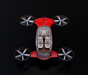 黒バックに自動運転ドローンのカットモデルイメージ。空飛ぶ車インテリアのコンセプトの写真素材 [FYI04646515]
