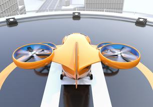 高層ビルの屋上にあるヘリポートに待機中のドローンタクシー。空飛ぶタクシーのコンセプトの写真素材 [FYI04646532]