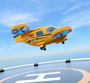 ヘリポートから離着陸している空飛ぶタクシーのコンセプトイメージの写真素材 [FYI04646542]