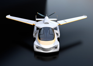 黒バックにフライングカー(空飛ぶ車)のコンセプトイメージの写真素材 [FYI04646777]