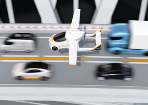 高速道路渋滞中の車列の上に通過するフライングカー(空飛ぶ車)のコンセプトイメージの写真素材 [FYI04646790]
