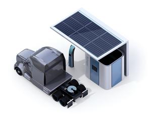 白バックにソーラーパネルが備える水素ステーションに水素ガス充填中のトラックのイメージの写真素材 [FYI04646846]