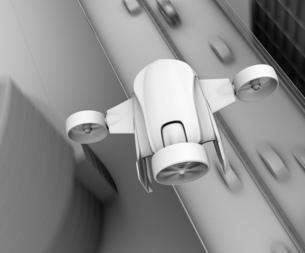 高速道路の上空を飛行するVTOL式配達ドローンのグレイシェーディングイメージの写真素材 [FYI04646851]