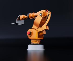 黒バックにオレンジ色の大型産業用ロボットのイメージの写真素材 [FYI04646877]