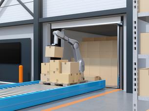 コンテナから荷降ろししているロボットのイメージ。スマート工場のコンセプトの写真素材 [FYI04646940]