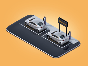 スマートフォンにカーシェアリング専用駐車場にある電気自動車のイメージの写真素材 [FYI04647057]