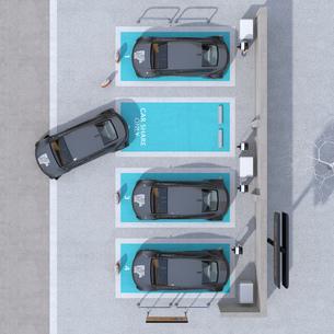 カーシェアリング専用駐車場に充電している電気自動車の鳥瞰イメージの写真素材 [FYI04647079]
